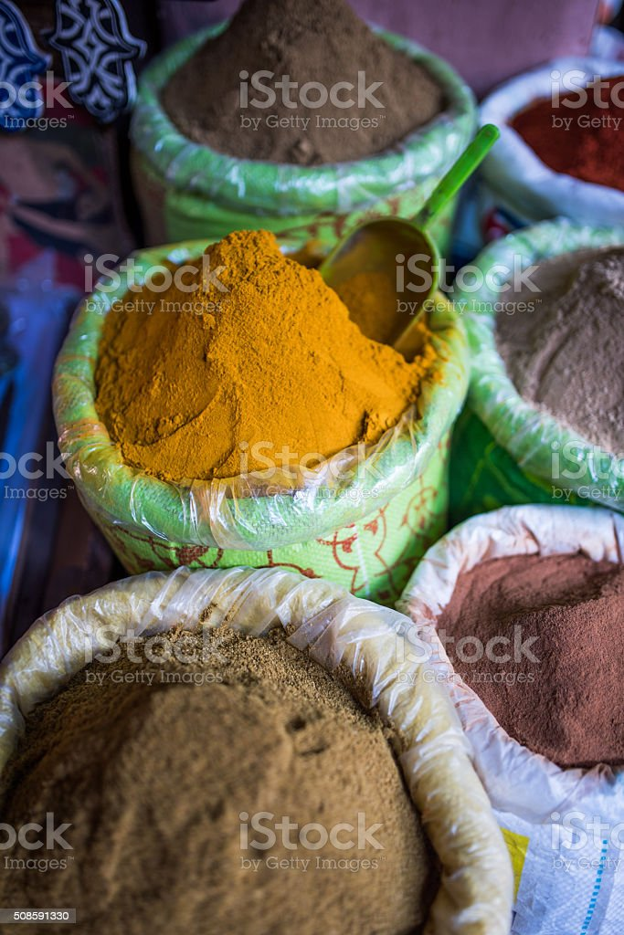 Spices for sale in plastic buckets stock photo