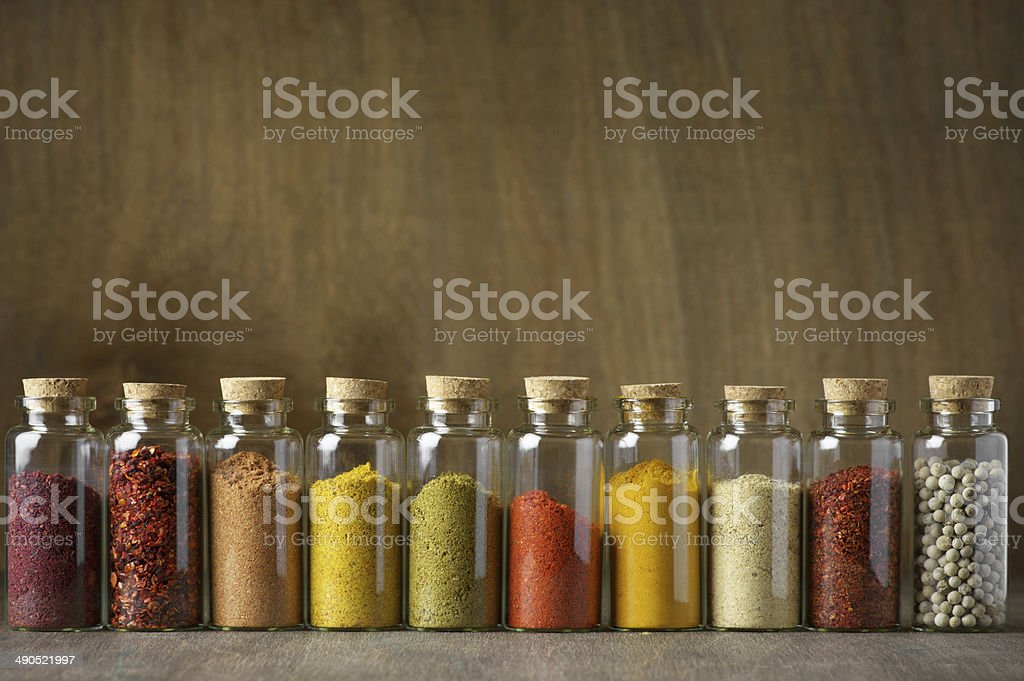 Spices in bottles stock photo