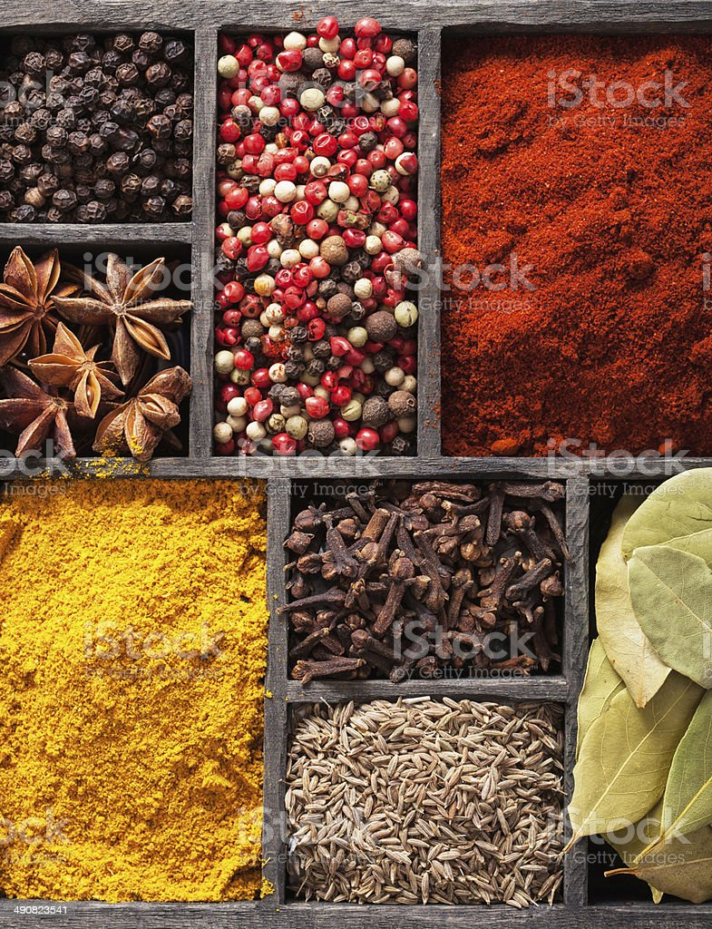 spices in box pink  black pepper, paprika powder, curry royalty-free stock photo