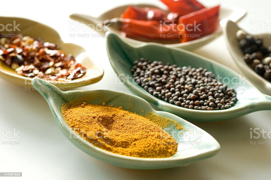 Spices in fancy leaf shaped bowls-2 royalty-free stock photo