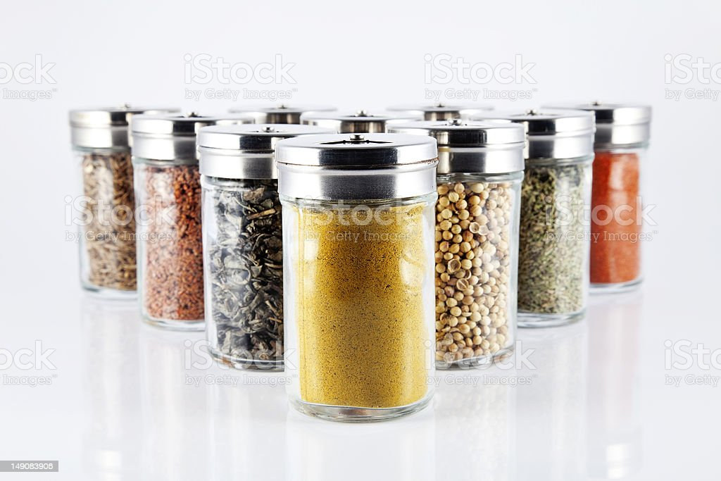 spices in glass bottles royalty-free stock photo