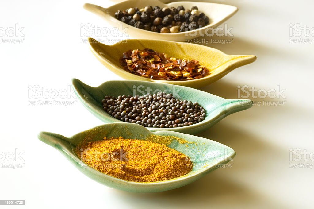 Spices in leaf shaped fancy bowls royalty-free stock photo