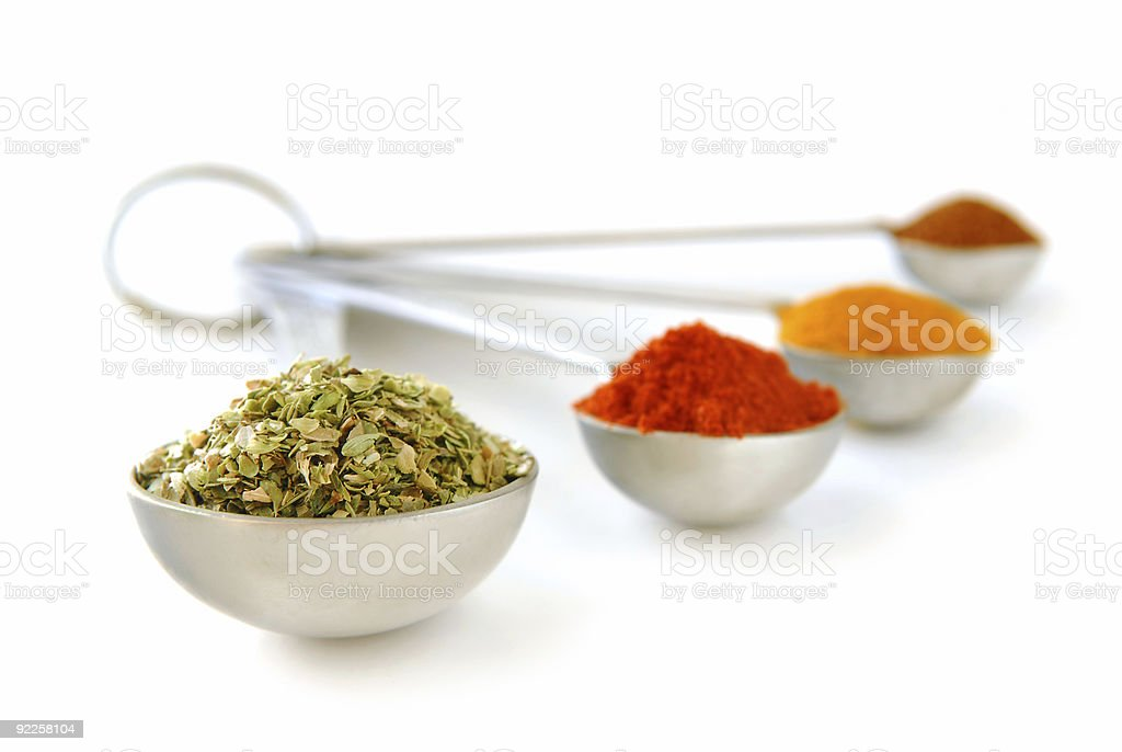 Spices in measuring spoons royalty-free stock photo