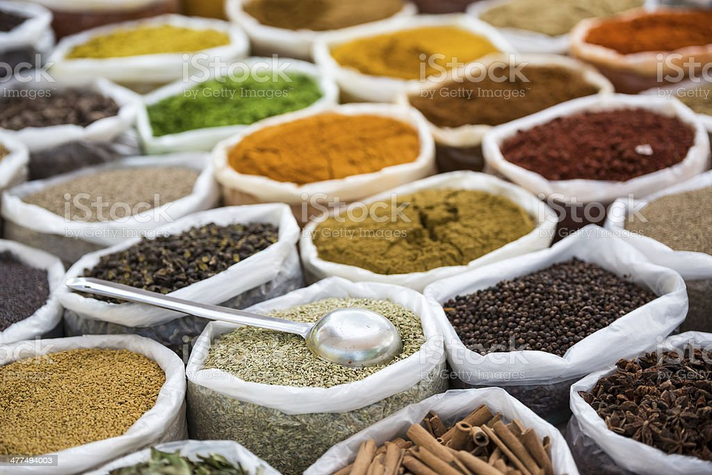 Spices in white sacks stock photo