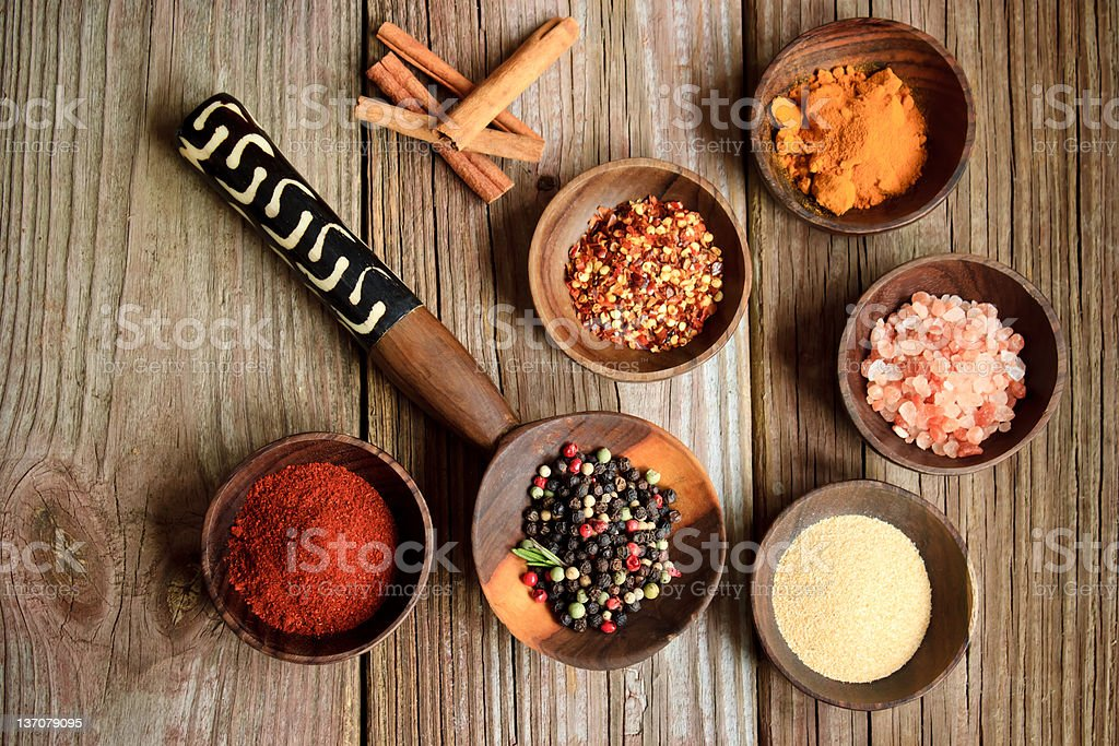 Spices in wooden bowls stock photo