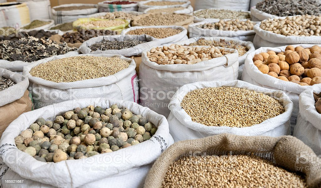 spices, nuts and beans in bags stock photo