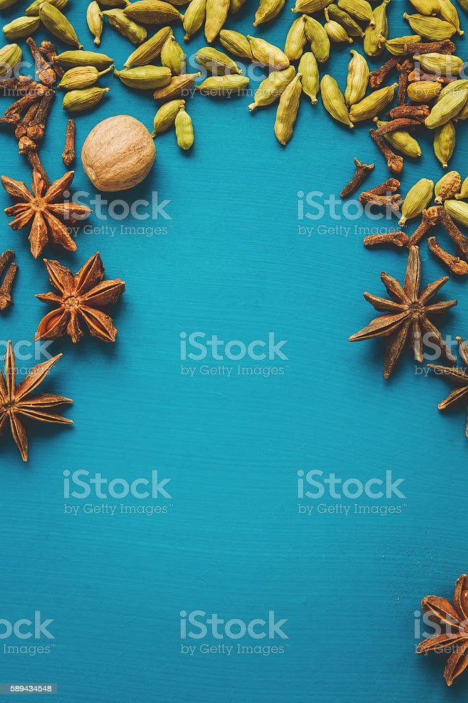 Spices on a blue table stock photo