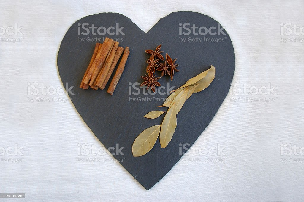 Spices on a heart shaped slate stock photo