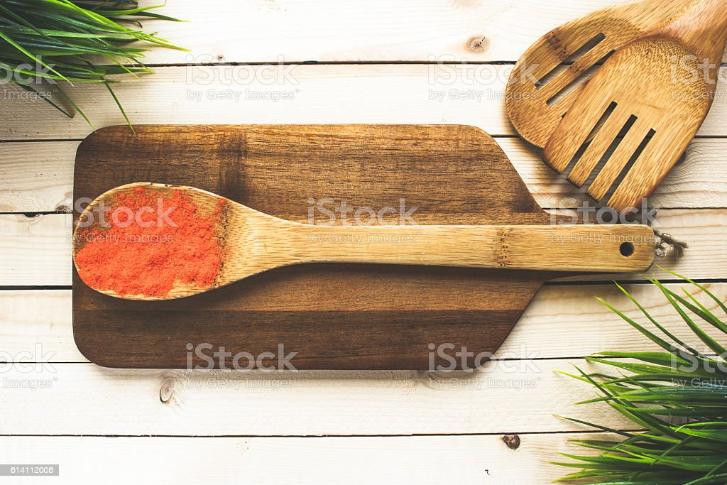Spices on a wooden board near with kitchenware stock photo