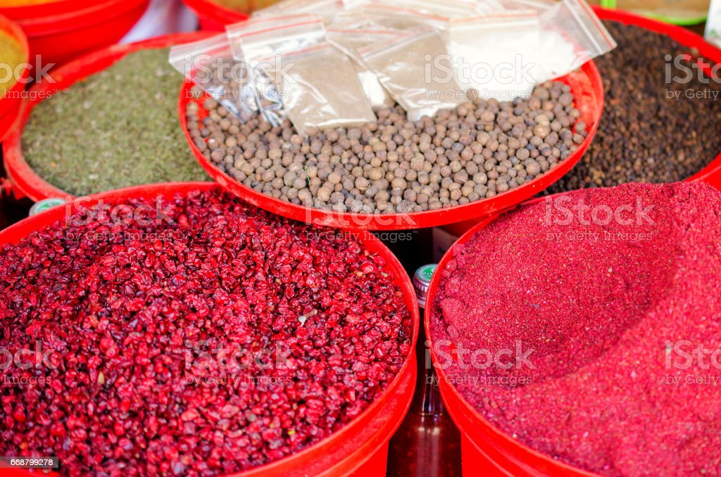 Spices on the market in colorful containers. stock photo