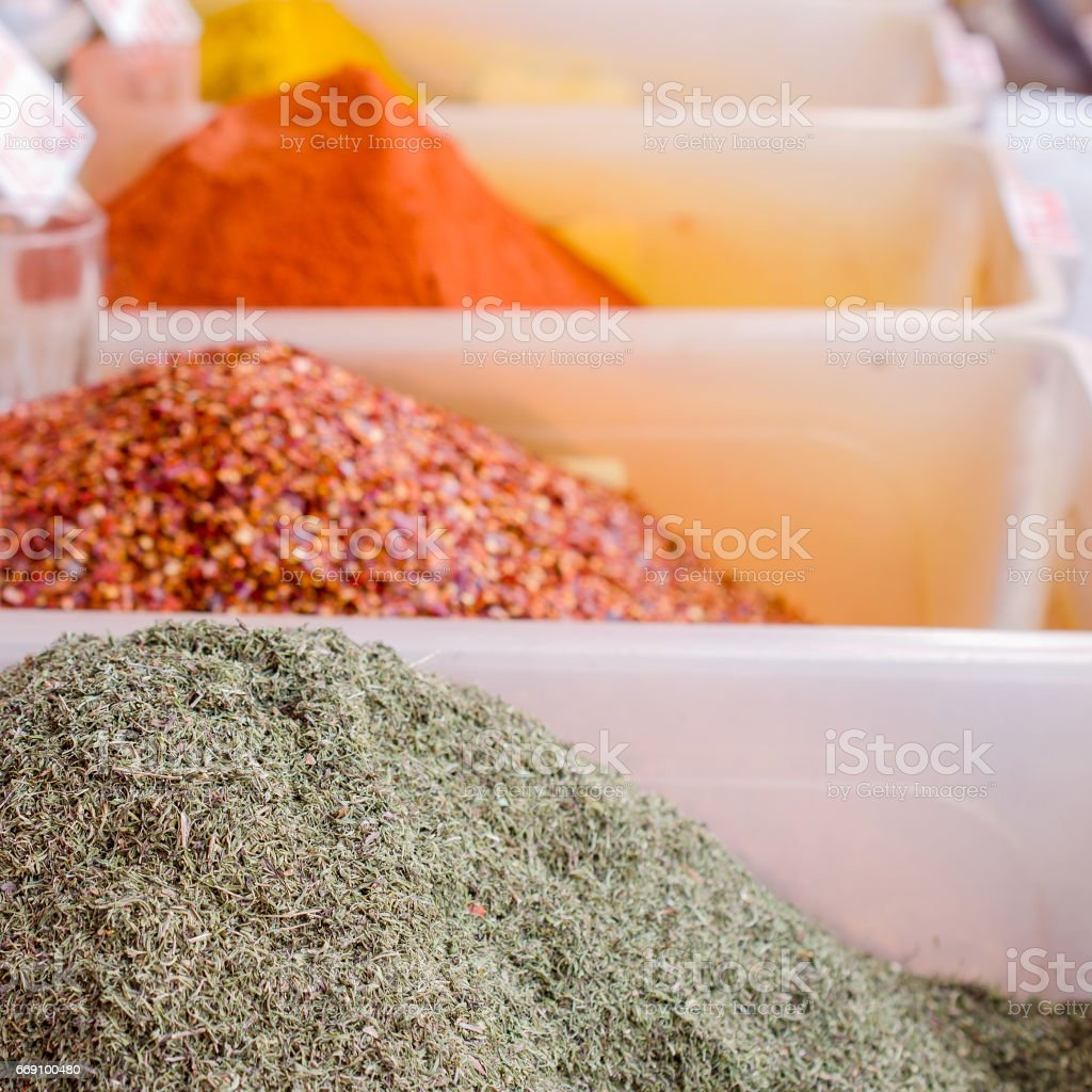 Spices on the market in white containers. stock photo