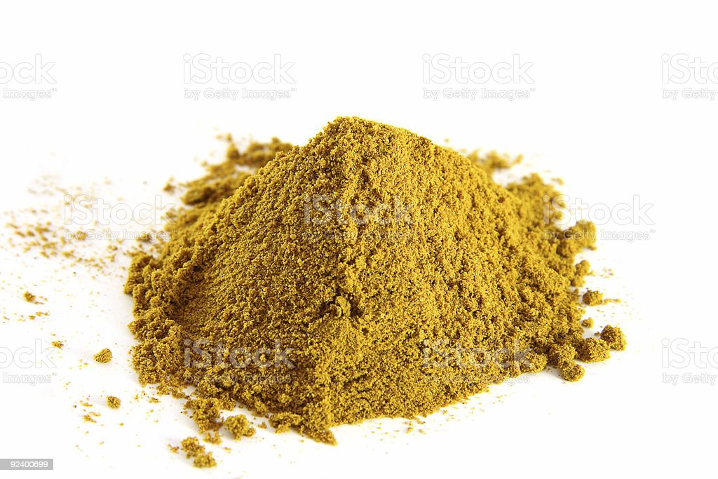 spices pile of curry powder on white background royalty-free stock photo