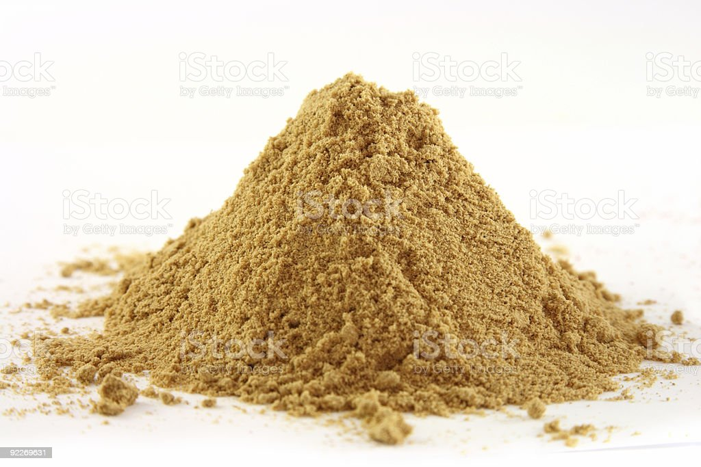 spices pile of ground ginger on white background royalty-free stock photo