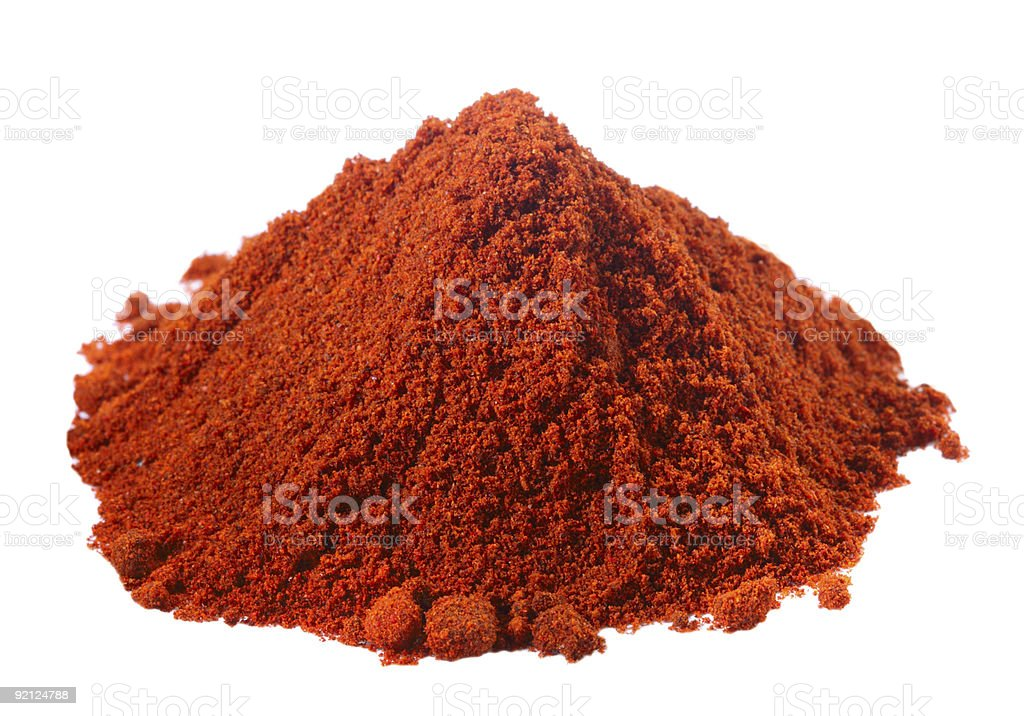 spices - pile of red paprika over white royalty-free stock photo