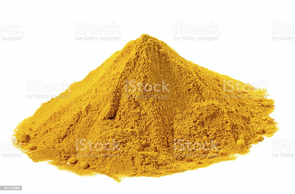 spices - pile of Yellow Turmeric over white stock photo