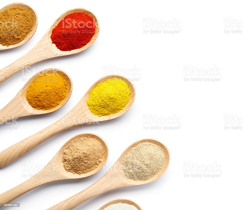 Spices Powder on Wooden Spoons stock photo
