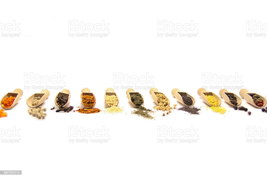 Spices. Spice in Wooden spoon. Herbs, Saffron, cinnamon stock photo