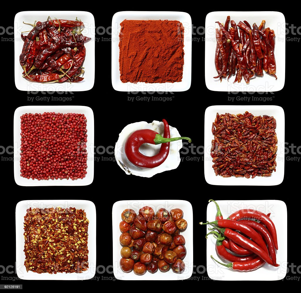 RED spices WHITE plates BLACK background stock photo