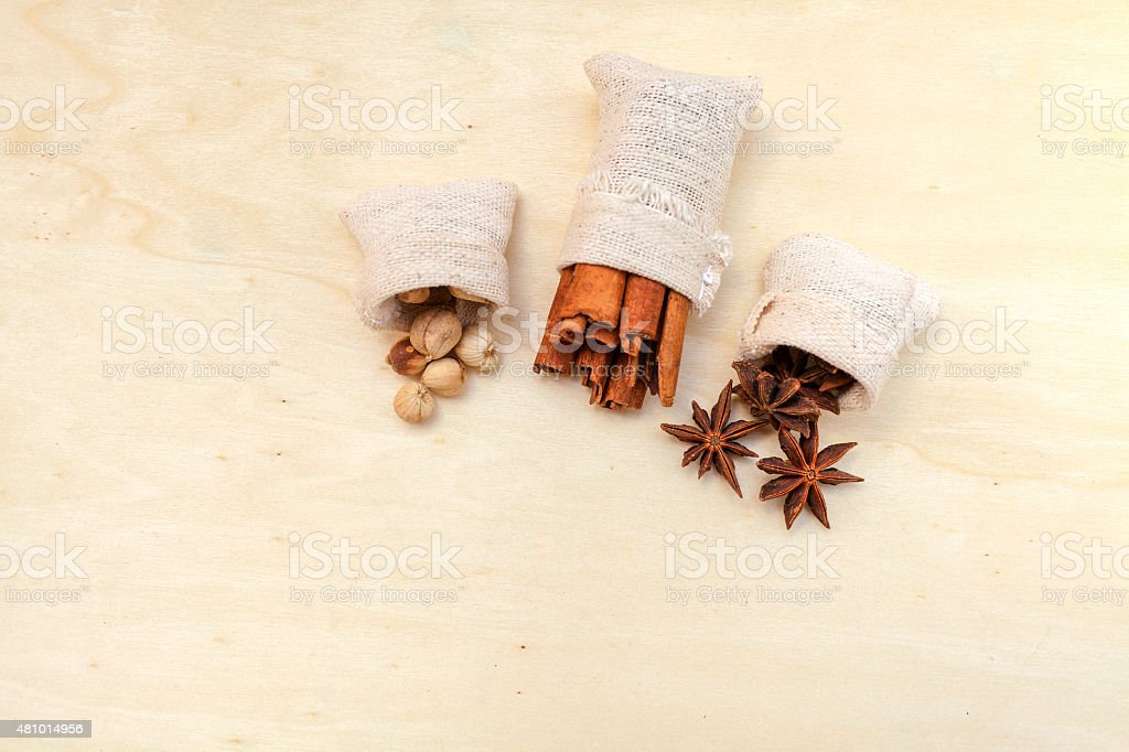 Spices with space on wood background stock photo
