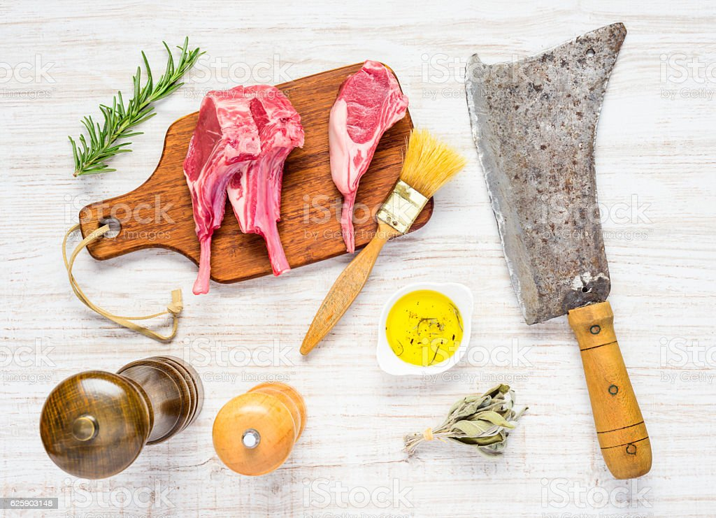 Spicing Lamb Chops and Meat Cleaver stock photo