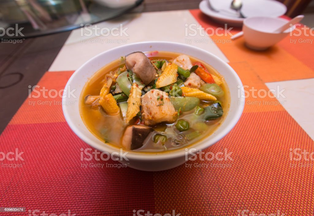 Spicy and hot king fish curry with kaffir lime leaves stock photo