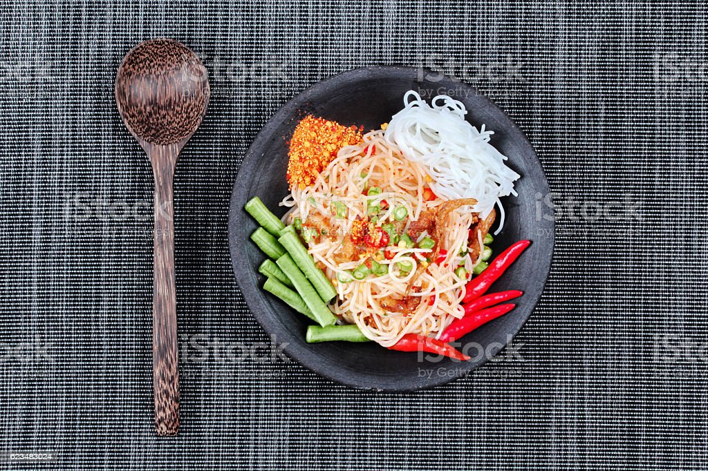 Spicy and sour mixed vegetable salad with rice noodle served . stock photo