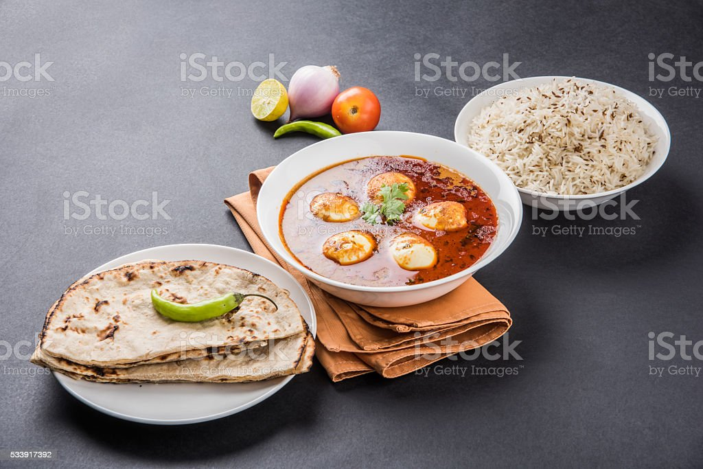 spicy anda curry or egg curry with roti and rice stock photo