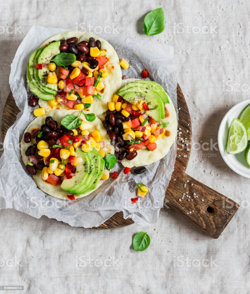Spicy bean tacos with corn salsa and avocado stock photo
