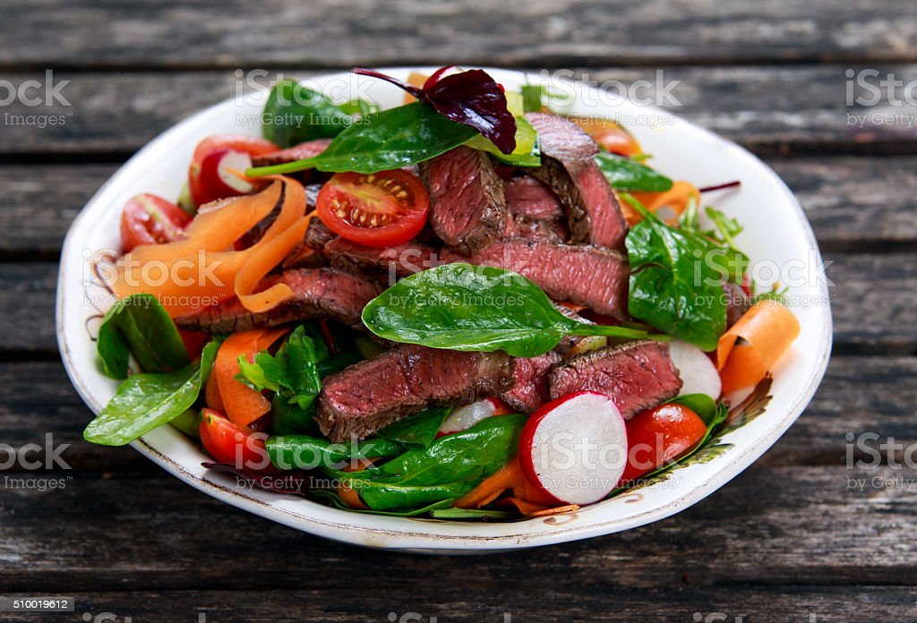 Spicy Beef Slices Meat Salad with vegetables. stock photo