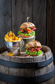 Spicy burger with beef, cheese and vegetables