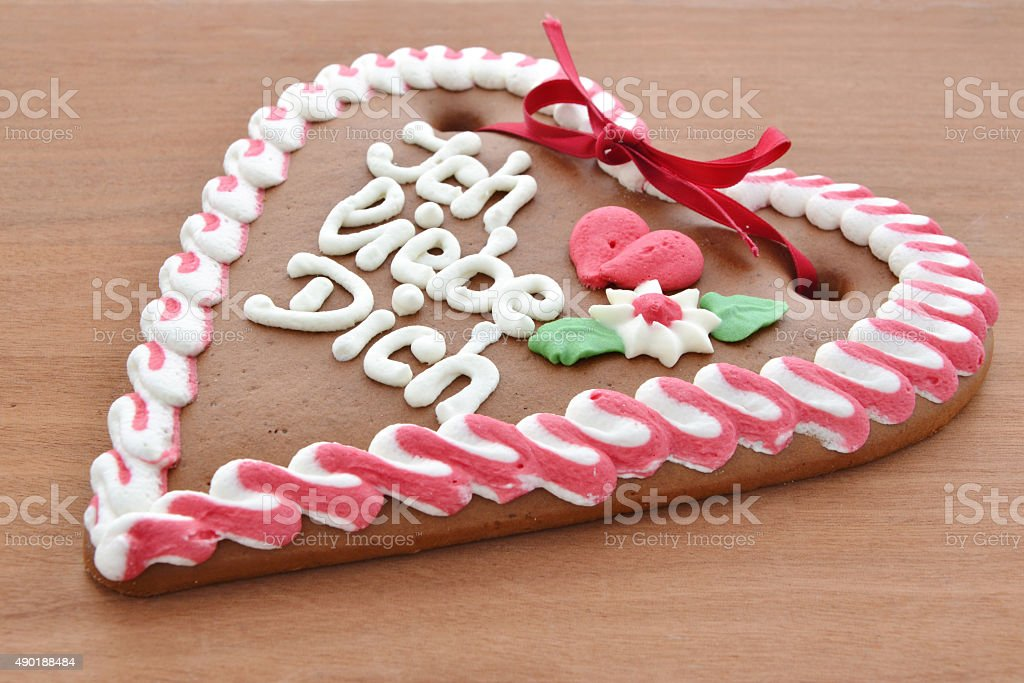 Spicy cake in heart shape is on the table stock photo