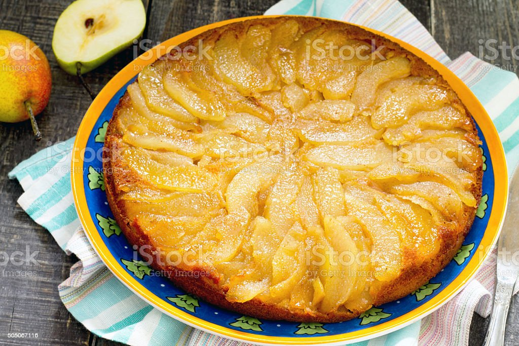 Spicy cake with caramel, pear and cinnamon stock photo