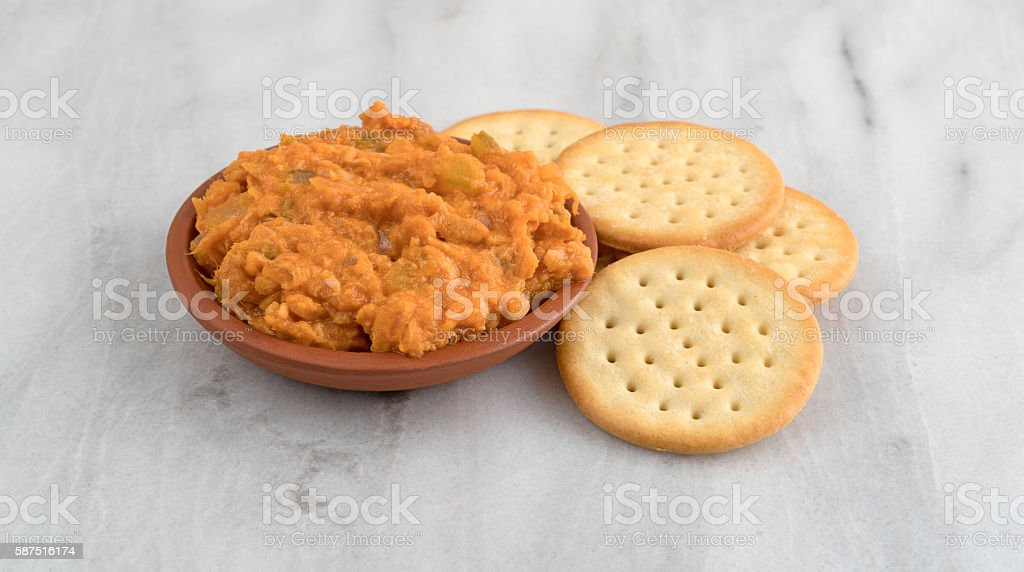 Spicy chicken salad in bowl with butter crackers stock photo
