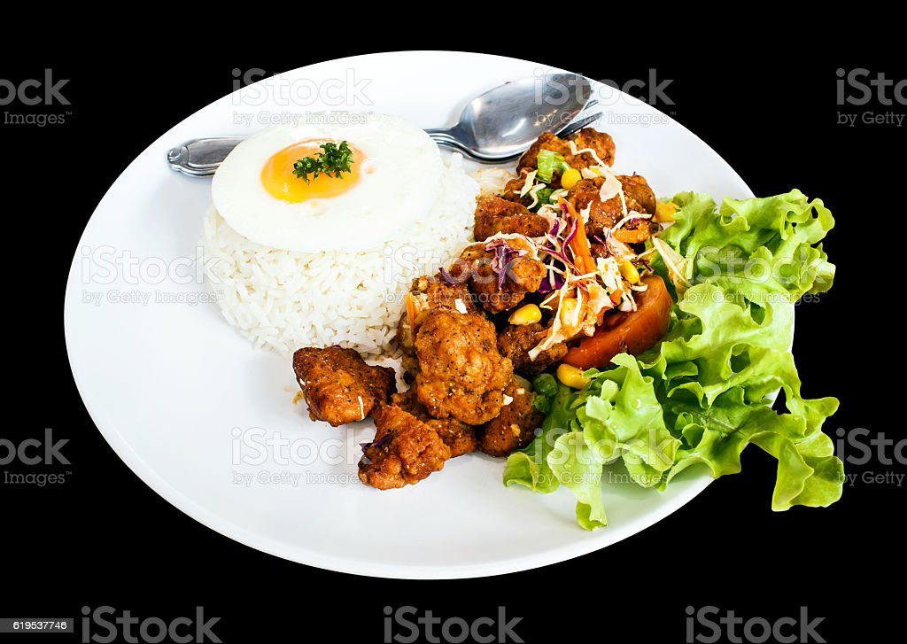 Spicy Chicken with rice and fried egg stock photo