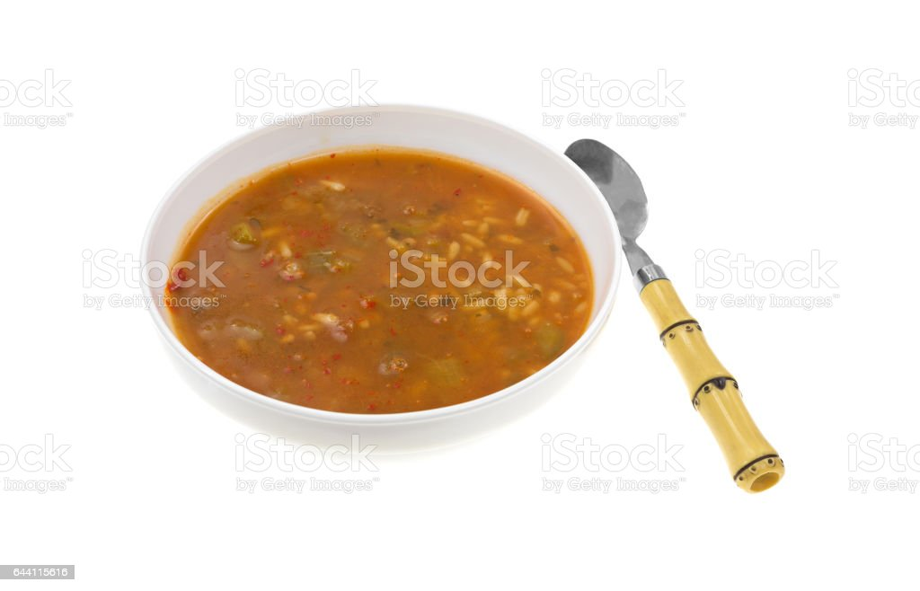 Spicy chicken with rice vegetable soup with spoon stock photo