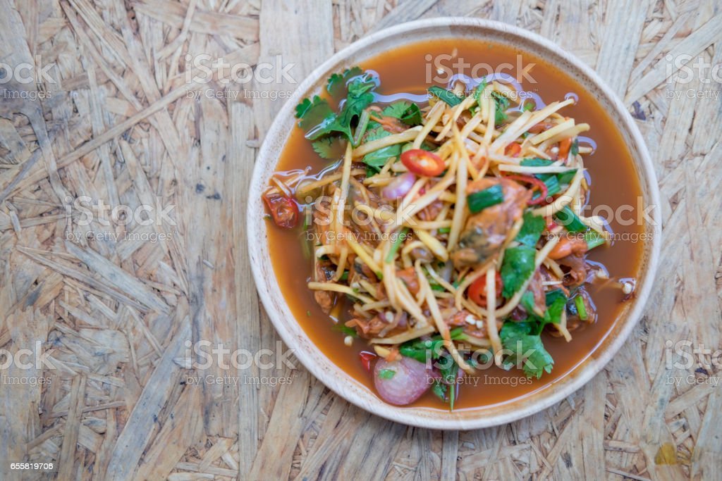 spicy cockle salad on wooden background, selection focus stock photo
