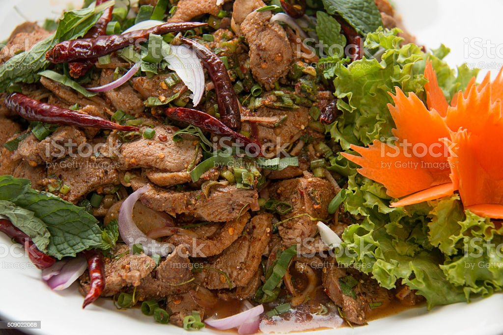 Spicy duck salad with vegetables stock photo