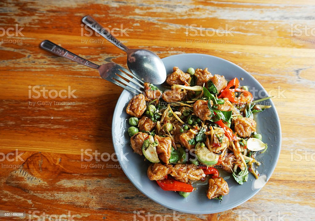 Spicy fried fish balls dish with Utensils stock photo