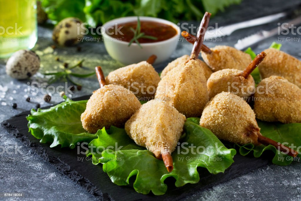 Spicy fried quail legs, chicken in batter with breadcrumbs on the kitchen table. Fast food. stock photo