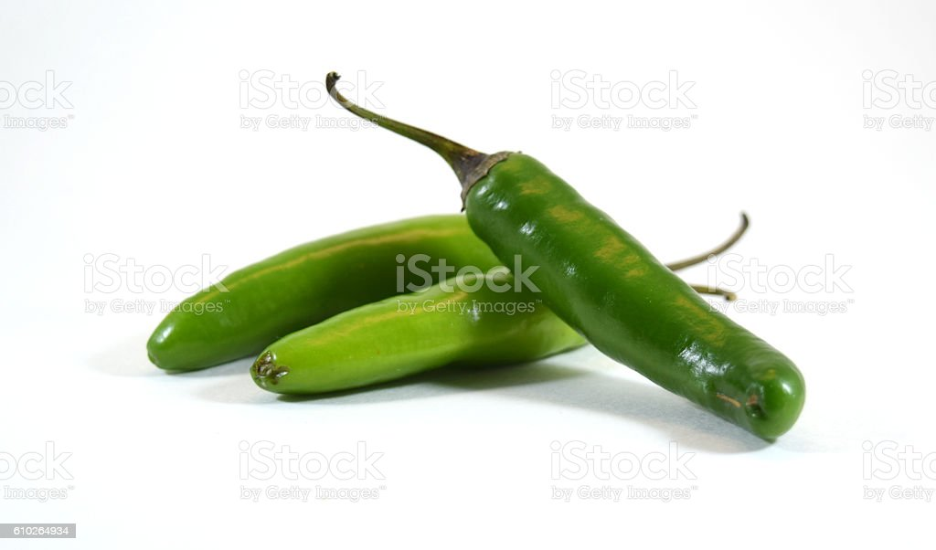 Spicy green serrano pepper pile stock photo
