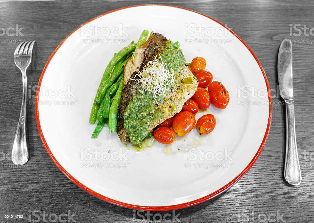 Spicy grilled sea bass steak stock photo