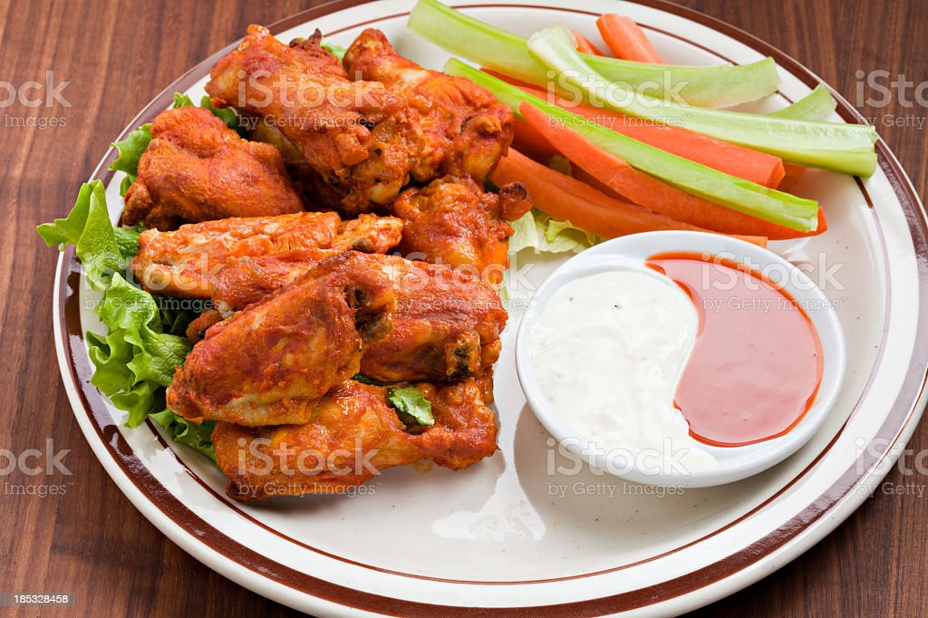 Spicy Hot Wings And Two Kinds Of Dipping Sauce royalty-free stock photo