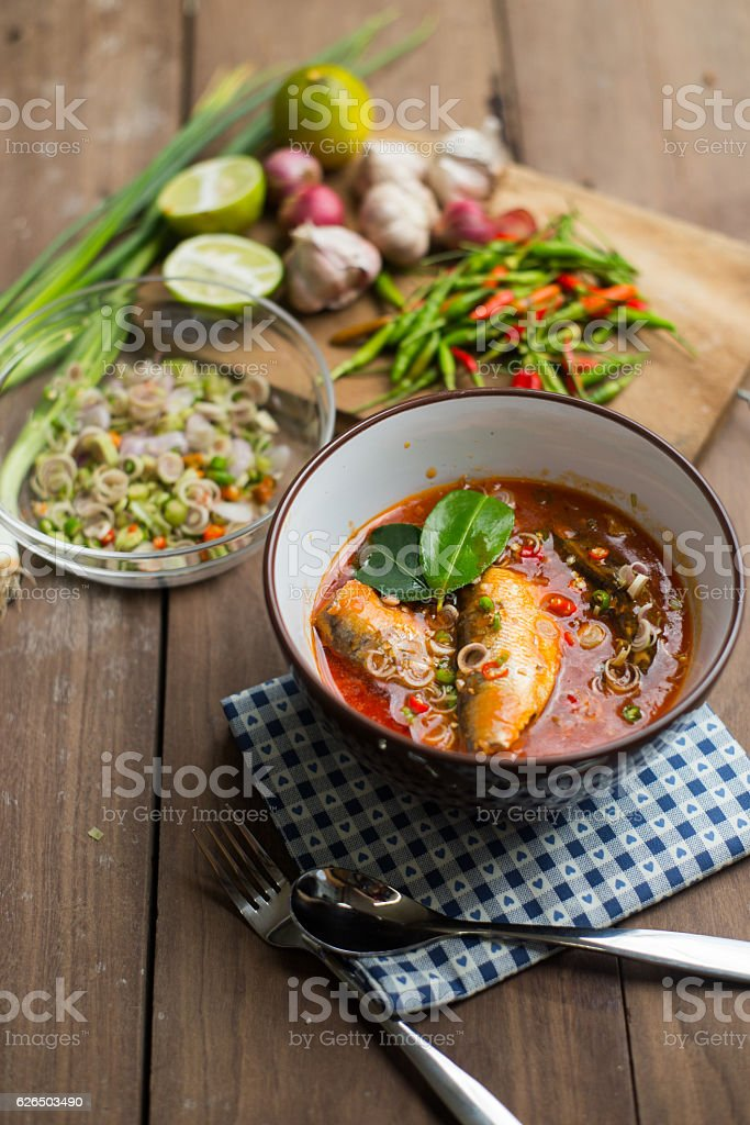 Spicy mackerels salad in tomato sauce stock photo