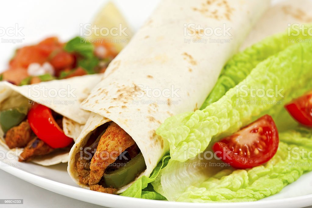 Spicy mexican fajita wraps on a white background royalty-free stock photo