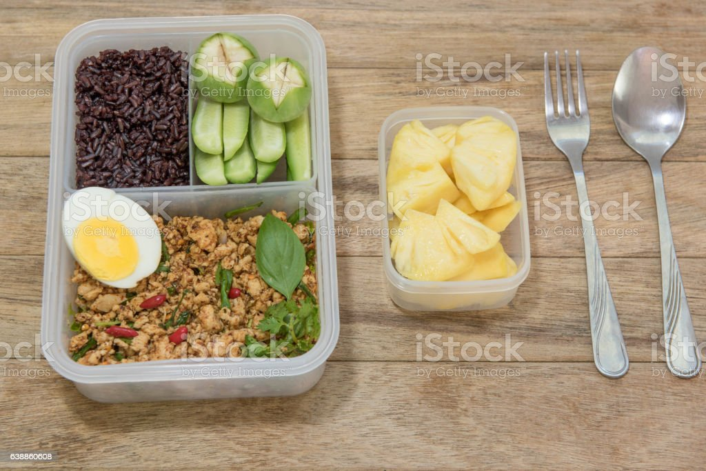 Spicy minced chicken breast salad,rice berry,boiled egg stock photo