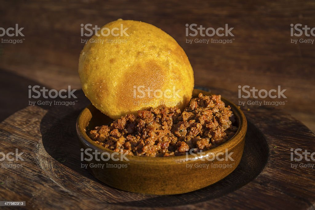 Spicy minced meat with corn bread royalty-free stock photo
