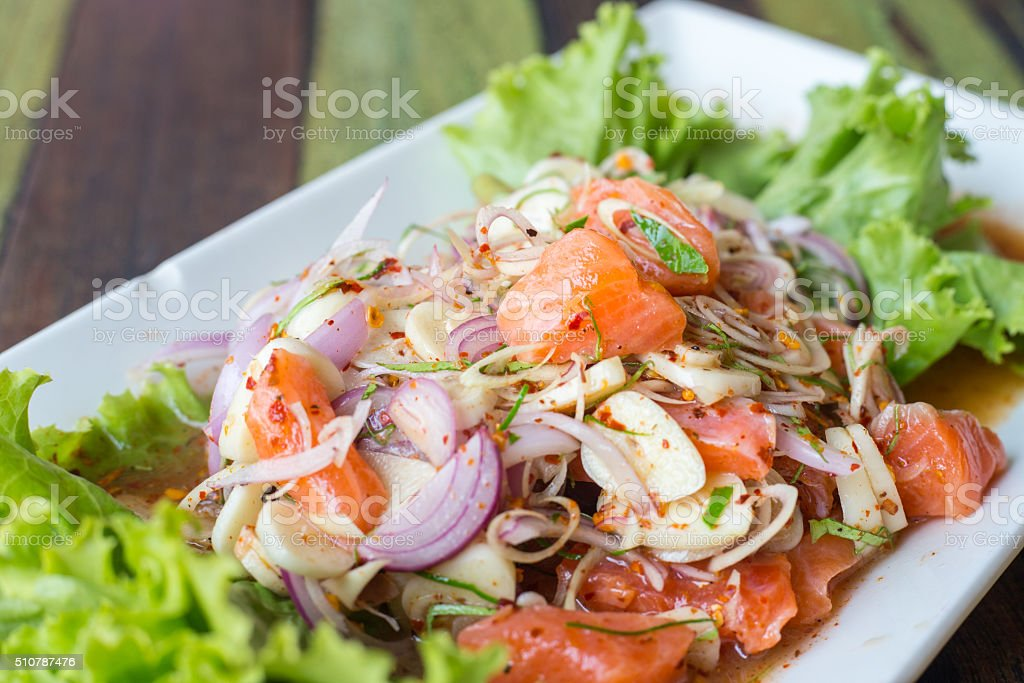 Spicy minced salmon with salad stock photo