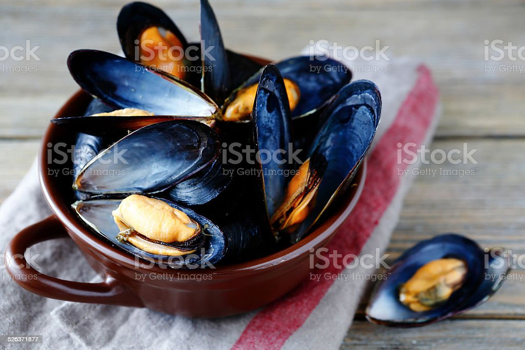Spicy mussels in the shell and sauce stock photo