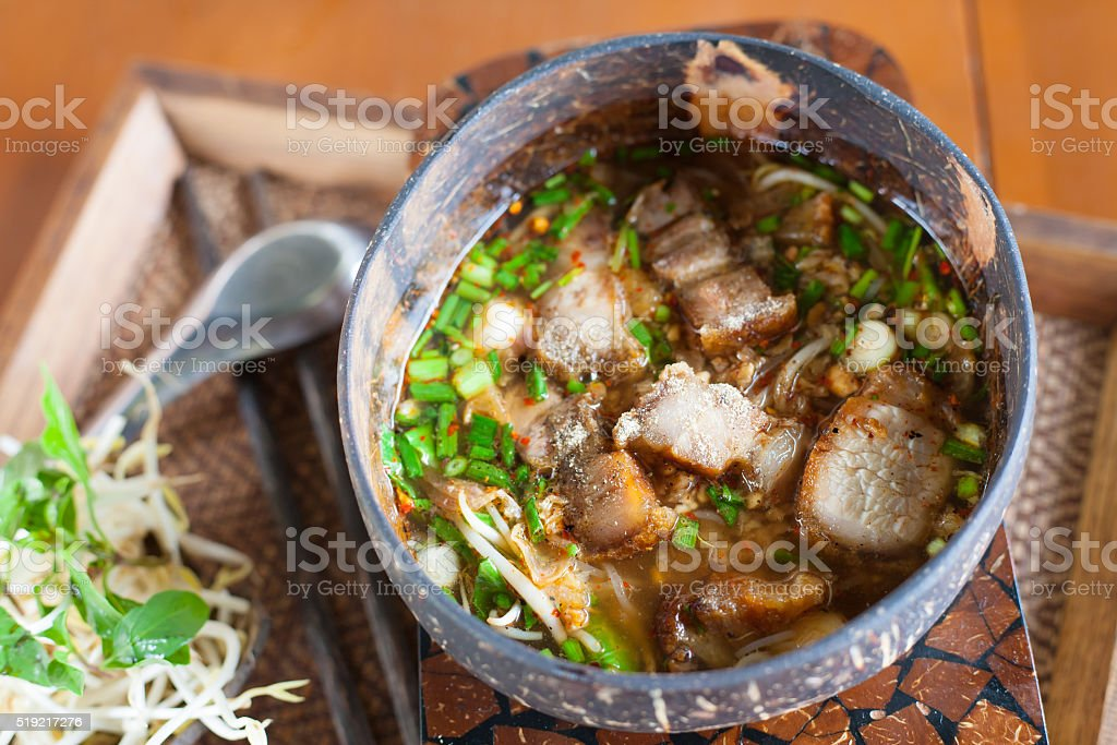 Spicy noodle soup with crispy pork stock photo