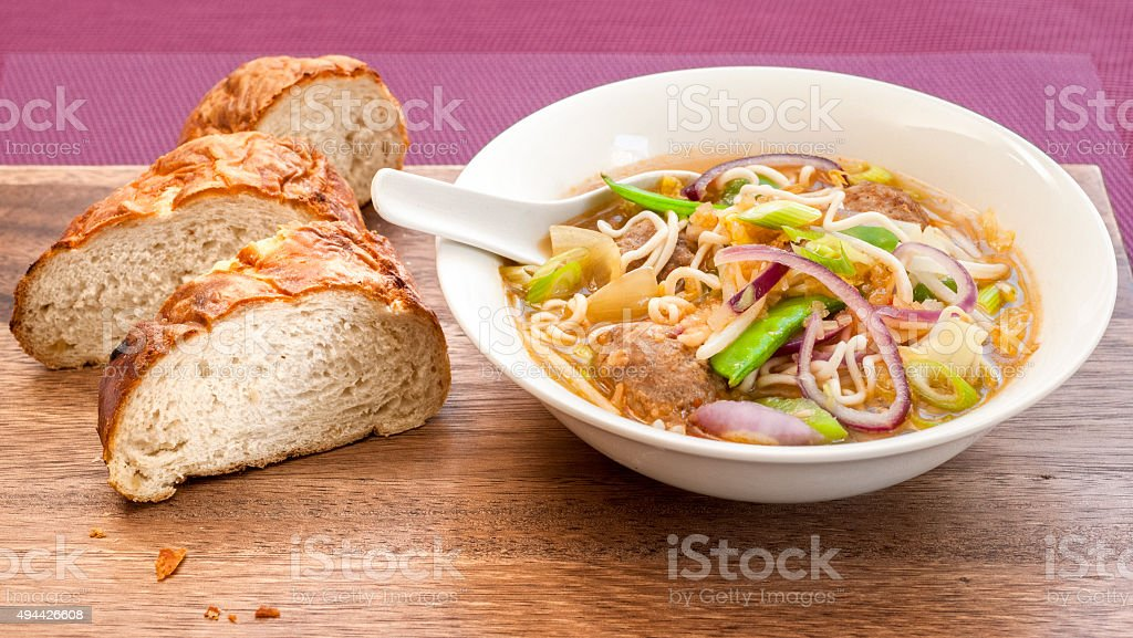 Spicy noodle soup with little meat balls stock photo